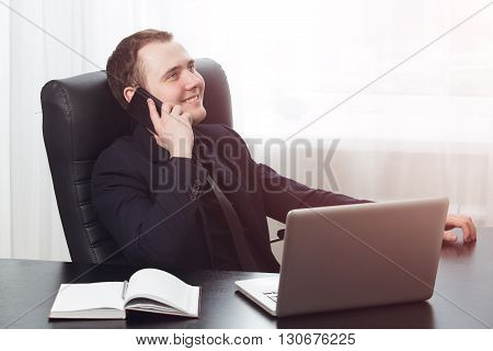 Smiling man in formal clothes call his family at break