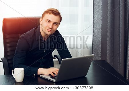 Freelance journalist making an article at home