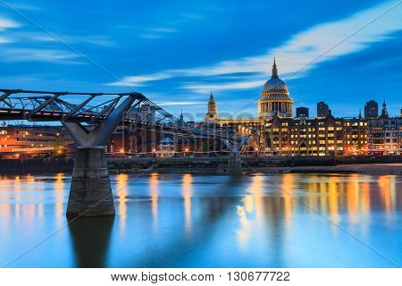 Millennium Bridge leading to Saint Paul's Cathedral during sunset in central London UK