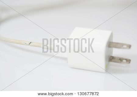 Closeup The Broken Charger Cable On White Background