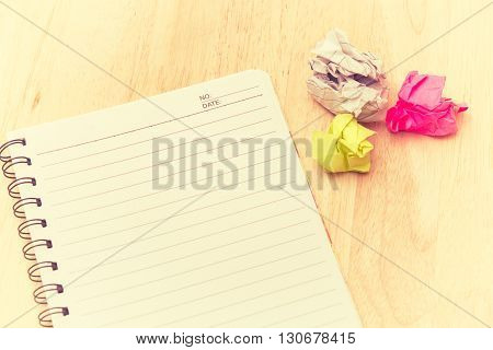 Writers Block. Paper Lump. On Wooden Background.vintage Tone