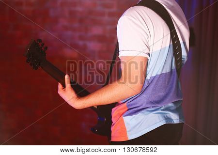 Man playing electric guitar.