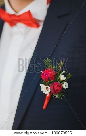 Close Up Of White And Red Rose Corsage On Man Suit