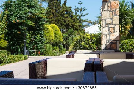 Green garden with outdoor furniture lounge group with chairs