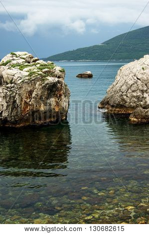 Landscape with two rocks in Adriatic Sea (the city Herceg Novi, Montenegro)