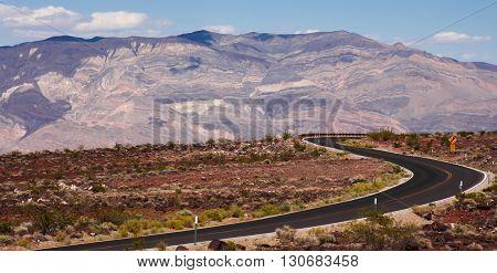 Long desert highway winding through Death Valley