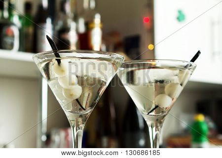 cool refreshing alcohol cocktail with martini onion