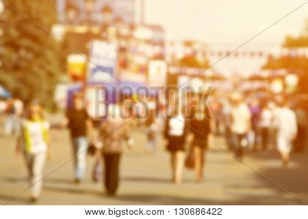 blurred background of people walking on a city street