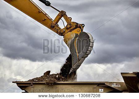 Construction Industry Excavator Loading Gravel Rock Closeup