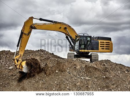 Constuction Industry Excavator Heavy Equipment Digging On Gravel Hill