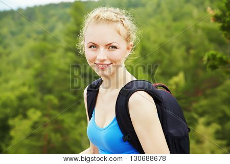 young woman with backpack hiking in the mountains. people outdoors