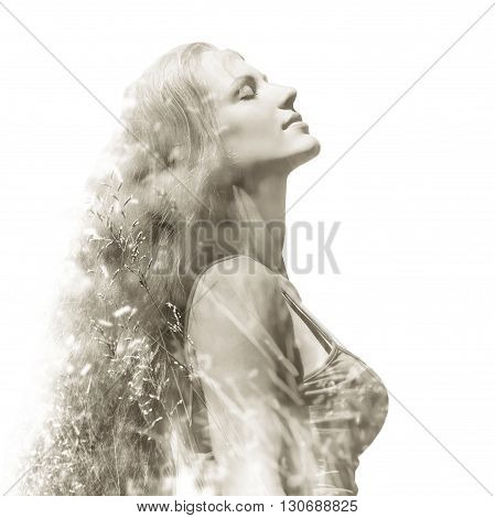 double exposure outdoor closeup portrait of a beautiful young woman with long hair. colorized and toned photo