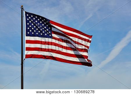 Flag Usa In Wind On Flagpole With Sky And Clouds