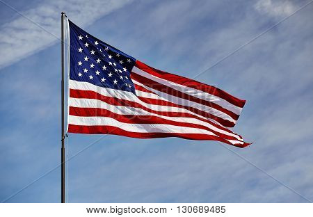 Flag Usa Waving In Wind Blue Sky And Clouds