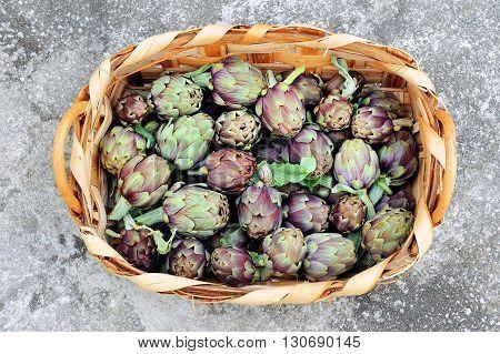 fresh artichokes in wicker basket from the top