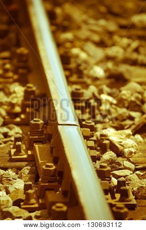 Old rusty railway tracks, vintage style, yellowish-brown