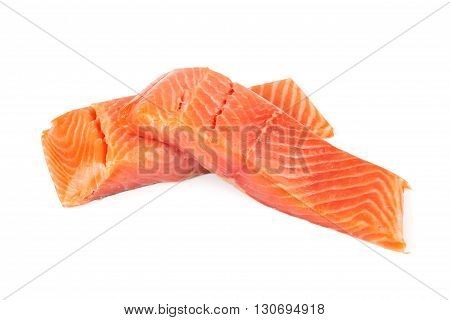 Sliced raw salmon isolated on white background