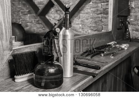Tools hairdressers. Barber Tools on a wooden background