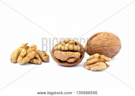 Pile of walnuts isolated on white background