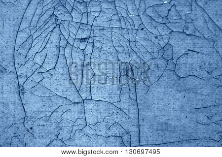 Close-up detail of cracked paint on wall. black and blue