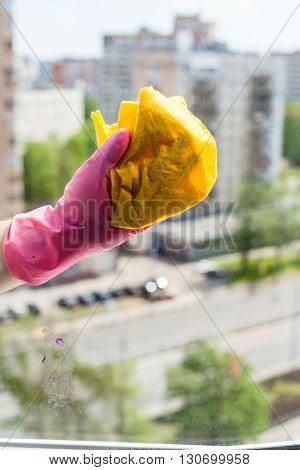 Washer Cleans Window Glass By Rag In Urban House
