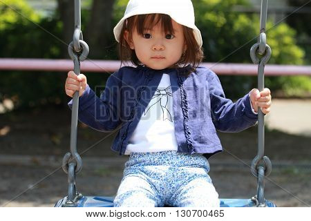 Japanese girl on the swing (1 year old)