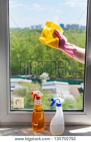 Washer Cleans Window Glass By Rag In Sunny Day