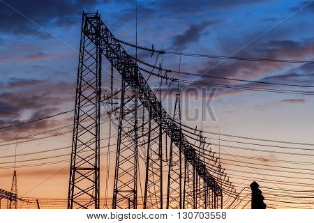 Electric power station at sunset with dramatic sky