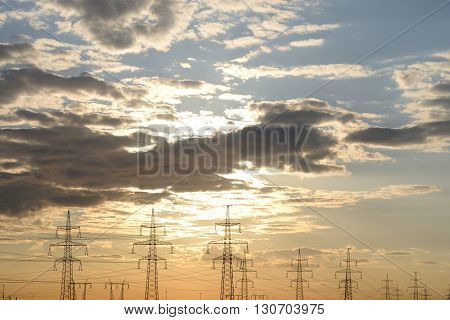 Power line in the countryside at sunset on the outskirts of St. Petersburg Russia.