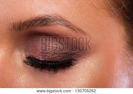 Great professional make-up eyes. Glitter eye shadow highlighter eyeliner. Eye of girl close-up.