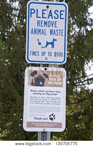 Brevard; North Carolina; USA - December 11; 2015:; Signs by the North Carolina Department of Environment and Natural Resources urge pet owners to clean up their dog's poop for the health of the environment or pay a fine