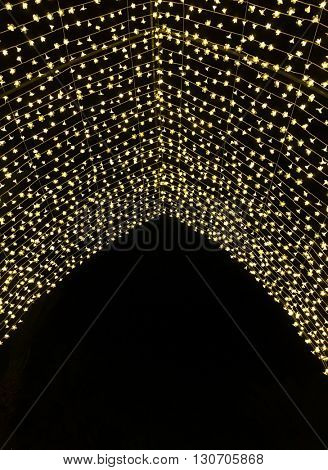 Ramadan decorative lights. A festive background. An arch with tiny blurred christmas lights.
