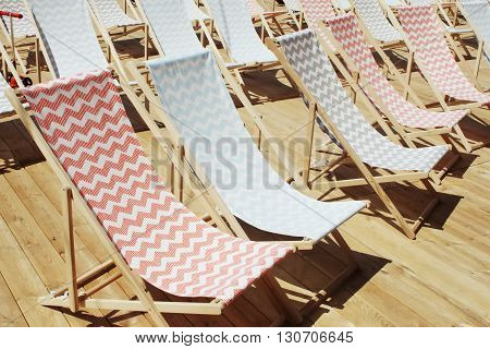 many colored patterned chairs chaise-longue on event