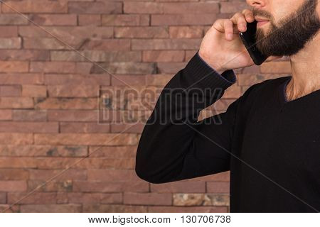 The young successful man with the phone