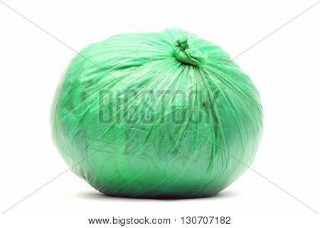 Green rubbish bag isolated on a white