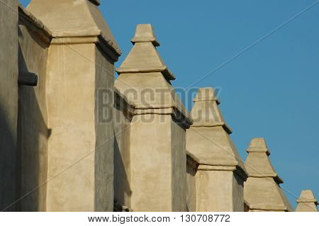 a picture of an exterior 19th century adobe columns