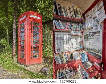 LYNDHURST UK, MAY 2016 - Exterior and Interior of a Telephone Box Now Used As Tourist Information and community center. The phone box was purchased from British Telecom under the UK wide adopt a kiosk scheme.