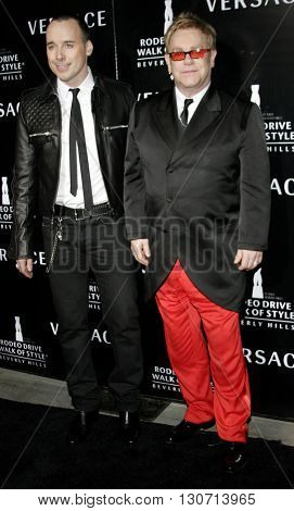 Elton John and David Furnish at the Rodeo Drive Walk Of Style Award honoring Gianni and Donatella Versace held at the Beverly Hills City Hall in Beverly Hills, USA on February 8, 2007.