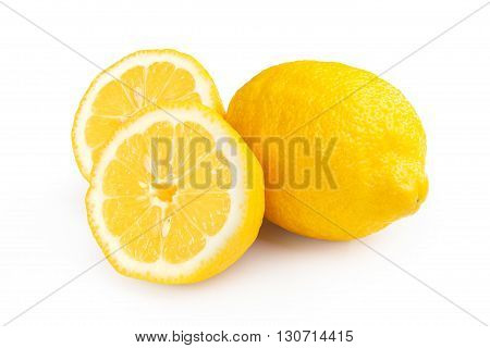 Fresh ripe lemons isolated on white background. Lemon in a cut. Half of lemon.