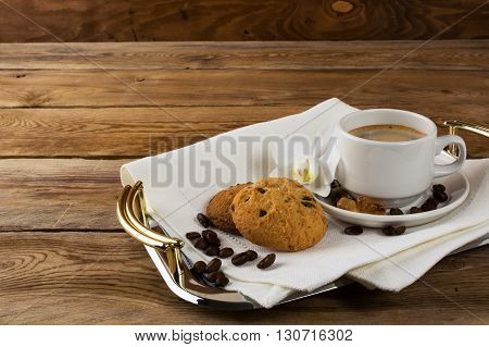 Tea and cookies on serving tray. Homemade biscuit. Homemade cookies.Sweet dessert. Breakfast cookies. Sweet pastry. Cup of tea. Tea cup. Breakfast tea.