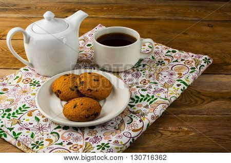 Breakfast tea on wooden background. Homemade biscuit. Homemade cookies.Sweet dessert. Breakfast cookies. Sweet pastry. Cup of tea. Tea cup. Breakfast tea.