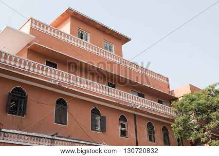 Residential apartments colored with pink color in Jaipur city of Rajasthan. Jaipur is known as the pink city for its red soil and majority of the buildings are pink in color.