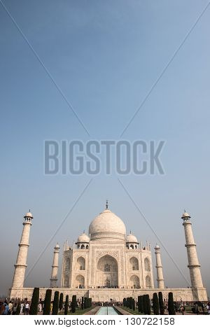 Beautiful Taj Mahal in memory of Mumtaz, wife of Shah Jahan in Agra. Built of Makrana marble, Taj Mahal depicts impeccable beauty. The reflecting pool is also seen.