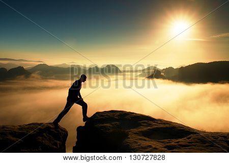 Crazy Hiker In Black Is Jumping Between The Rocky Peaks. Wonderful Daybreak In Rocky Mountains, Heav