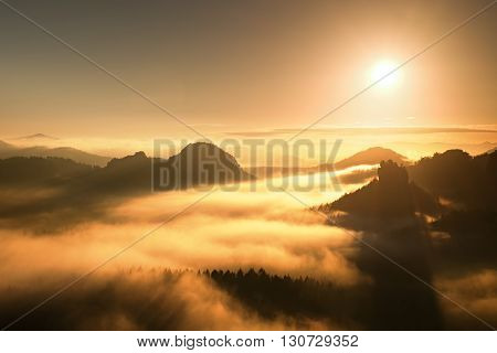 Sunrise In A Beautiful Mountain Of Czech-saxony Switzerland. Sandstone Peaks Increased From Fog, The
