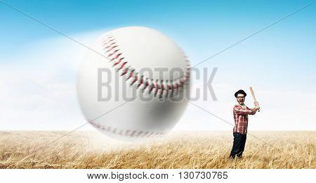 Young man with baseball