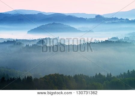 Misty Morning. Autumn Fog And Clouds Above Freeze  Mountain Valley, Hilly Landscape