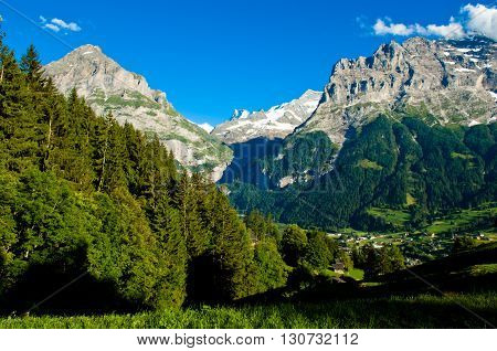 Grindelwald, Swiss Alps - snow capped mountains and deep valleys stunning view breath-taking panorama