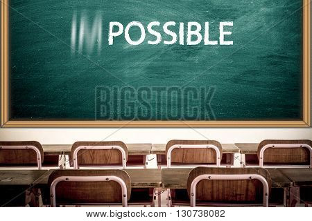 Impossible becomes possible with white chalk on blackboard in the class room