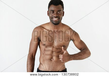 Isolated Portrait Of Healthy Muscular Dark Skinned Man With Beautiful Athlete Body Posing Shirtless